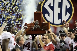 Dec 1, 2012; Atlanta, GA, USA; Alabama Crimson Tide head coach Nick Saban and his team hold the SEC trophy after winning the 2012 SEC Championship game against the Georgia Bulldogs at the Georgia Dome. Alabama won 32-28. (Daniel Shirey-USA TODAY Sports)