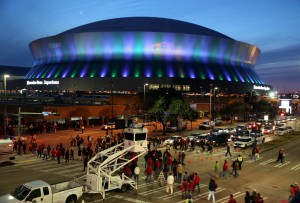 Jan 2, 2014; New Orleans, LA, USA; Football fans walk to the Mercedes-Benz Superdome before the Sugar Bowl between the Oklahoma Sooners and the Alabama Crimson Tide. Mandatory Credit: Chuck Cook-USA TODAY Sports