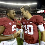 Oct 19, 2013; Tuscaloosa, AL, USA; Alabama Crimson Tide quarterback Blake Sims (6) greets quarterback A.J. McCarron (10) following their 52-0 victory over the Arkansas Razorbacks at Bryant-Denny Stadium. Mandatory Credit: John David Mercer-USA TODAY Sports