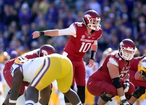Nov 29, 2013; Baton Rouge, LA, USA; Arkansas Razorbacks quarterback Brandon Allen (10) prepares for the snap against the LSU Tigers in the first quarter at Tiger Stadium. Mandatory Credit: Crystal LoGiudice-USA TODAY Sports