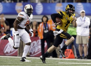 Jan 3, 2014; Arlington, TX, USA; Missouri Tigers quarterback Maty Mauk (7) runs the ball while Oklahoma State Cowboys safety Daytawion Lowe (8) defends in the first quarter at the 2014 Cotton Bowl at AT&T Stadium. Mandatory Credit: Tim Heitman-USA TODAY Sports