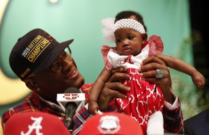 Feb 3, 2016; Montgomery, AL, USA; Carver high school linebacker Lyndell Wilson aka Mack Wilson holds his baby sister, Lemara Wilson , after he chooses to play for the Alabama Crimson Tide at Carver High School. Mandatory Credit: Butch Dill-USA TODAY Sports