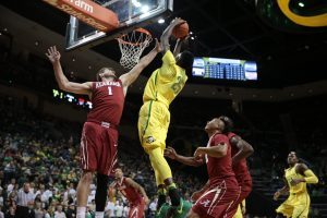 Dec 11, 2016; Eugene, OR, USA; Oregon Ducks forward Chris Boucher (25) dunks the ball as Alabama Crimson Tide guard Riley Norris (1) and Alabama Crimson Tide guard Dazon Ingram (12) watch at Matthew Knight Arena. Mandatory Credit: Scott Olmos-USA TODAY Sports