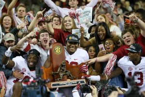Dec 3, 2016; Atlanta, GA, USA; Alabama Crimson Tide defensive lineman Raekwon Davis (99) celebrates with the trophy after the SEC Championship college football game against the Florida Gators at Georgia Dome. Alabama defeated Florida 54-16. Mandatory Credit: Jason Getz-USA TODAY Sports