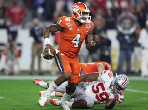 Dec 31, 2016; Glendale, AZ, USA; Clemson Tigers quarterback Deshaun Watson (4) scrambles away from Ohio State Buckeyes defensive end Tyquan Lewis (59) at University of Phoenix Stadium. Mandatory Credit: Matthew Emmons-USA TODAY Sports