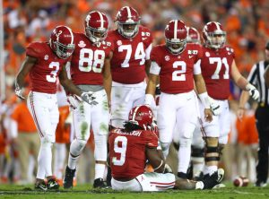 Jan 9, 2017; Tampa, FL, USA; Alabama Crimson Tide running back Bo Scarbrough (9) sits no the field after being injured during the third quarter against the Clemson Tigers in the 2017 College Football Playoff National Championship Game at Raymond James Stadium. Mandatory Credit: Mark J. Rebilas-USA TODAY Sports