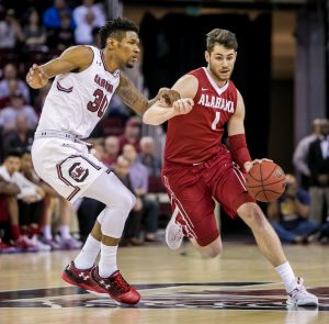 Feb 7, 2017; Columbia, SC, USA; Alabama Crimson Tide guard Riley Norris (1) drives around South Carolina Gamecocks forward Chris Silva (30) in the first half at Colonial Life Arena. Mandatory Credit: Jeff Blake-USA TODAY Sports