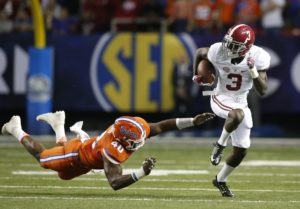 Dec 3, 2016; Atlanta, GA, USA; Alabama Crimson Tide wide receiver Calvin Ridley (3) runs the ball against Florida Gators linebacker Jarrad Davis (40) during the second quarter of the SEC Championship college football game at Georgia Dome. Mandatory Credit: Brett Davis-USA TODAY Sports