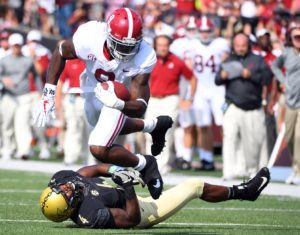 Sep 23, 2017; Nashville, TN, USA; Alabama Crimson Tide running back Bo Scarbrough (9) is tripped up by Vanderbilt Commodores linebacker Emmanuel Smith (4) after a short gain during the first half at Vanderbilt Stadium. Mandatory Credit: Christopher Hanewinckel-USA TODAY Sports