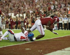 Sep 30, 2017; Tuscaloosa, AL, USA; Alabama Crimson Tide running back Bo Scarbrough (9) scores against the Mississippi Rebels during the first quarter at Bryant-Denny Stadium. Mandatory Credit: Marvin Gentry-USA TODAY Sports