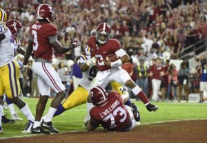 Nov 4, 2017; Tuscaloosa, AL, USA; Alabama Crimson Tide quarterback Jalen Hurts (2) scores a touchdown against the LSU Tigers during the third quarter at Bryant-Denny Stadium. Mandatory Credit: Adam Hagy-USA TODAY Sports