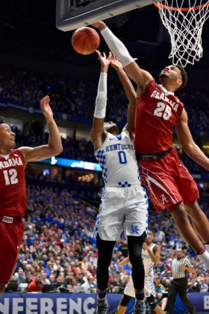 Mar 11, 2017; Nashville, TN, USA; Alabama Crimson Tide forward Braxton Key (25) blocks the shot attempt by Kentucky Wildcats guard De'Aaron Fox (0) during second half of game eleven of the SEC Conference Tournament at Bridgestone Arena. Kentucky won 79-74. Mandatory Credit: Jim Brown-USA TODAY Sports