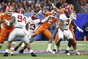 Jan 1, 2018; New Orleans, LA, USA; Alabama Crimson Tide linebacker Anfernee Jennings (33) hits Clemson Tigers quarterback Kelly Bryant (2) during the third quarter of the 2018 Sugar Bowl college football playoff semifinal game at Mercedes-Benz Superdome. Alabama Crimson Tide defensive lineman Da'Ron Payne (94) intercepted the ball. Mandatory Credit: Greg M. Cooper-USA TODAY Sports