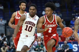 Mar 9, 2018; St. Louis, MO, USA; Alabama Crimson Tide guard Collin Sexton (2) races past Auburn Tigers guard Davion Mitchell (10) during the first half of the quarterfinals of the SEC Conference Tournament at Scottrade Center. Mandatory Credit: Billy Hurst-USA TODAY Sports