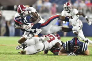 Sep 15, 2018; Oxford, MS, USA; Alabama Crimson Tide linebacker Joshua McMillon (40) tackles Mississippi Rebels running back Tylan Knight (4) during the fourth quarter at Vaught-Hemingway Stadium. Mandatory Credit: Matt Bush-USA TODAY Sports