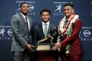Dec 8, 2018; New York, NY, USA; Heisman Trophy finalists (left to right) Ohio State Buckeyes quarterback Dwayne Haskins and Oklahoma Sooners quarterback Kyler Murray and Alabama Crimson Tide quarterback Tua Tagovailoa pose with the Heisman Trophy during a press conference at the New York Marriott Marquis before the Heisman Trophy announcement ceremony. Mandatory Credit: Brad Penner-USA TODAY Sports