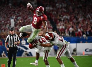 Dec 29, 2018; Miami Gardens, FL, USA; Alabama Crimson Tide running back Josh Jacobs (8) attempts to jump over Oklahoma Sooners cornerback Tre Brown (6) and linebacker Caleb Kelly (19) of the 2018 Orange Bowl college football playoff semifinal game at Hard Rock Stadium. Mandatory Credit: Jasen Vinlove-USA TODAY Sports