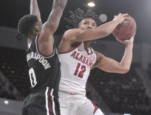 Feb 12, 2019; Starkville, MS, USA; Alabama Crimson Tide guard Dazon Ingram (12) shoots the ball past Mississippi State Bulldogs guard Nick Weatherspoon (0) during the second half at Humphrey Coliseum. Mandatory Credit: Justin Ford-USA TODAY Sports